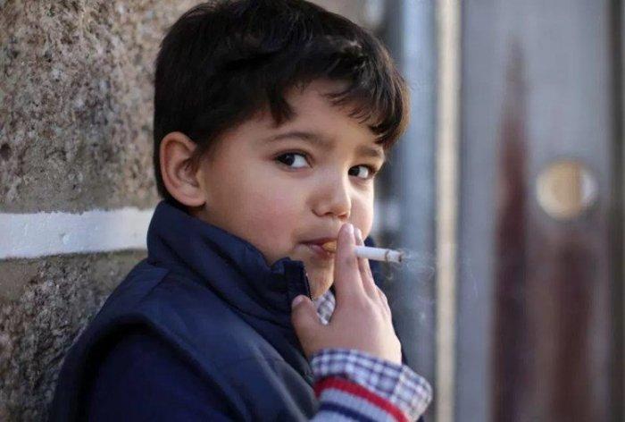 a-young-boy-smokes-a-cigarette_1515476410