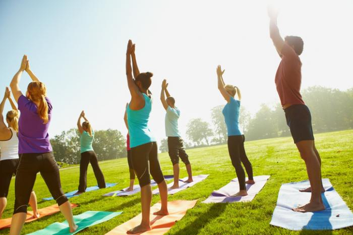 people-doing-yoga-in-the-park